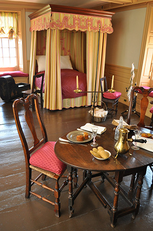 Historic bedroom with table and chairs in House of Seven Gables