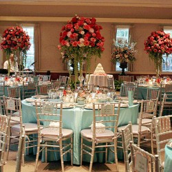 Corporate indoor event dining with centerpiece at House of Seven Gables