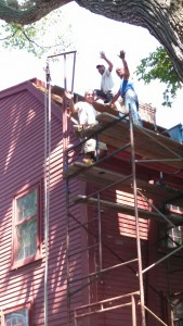 napco workers on birhtplace roof 2015